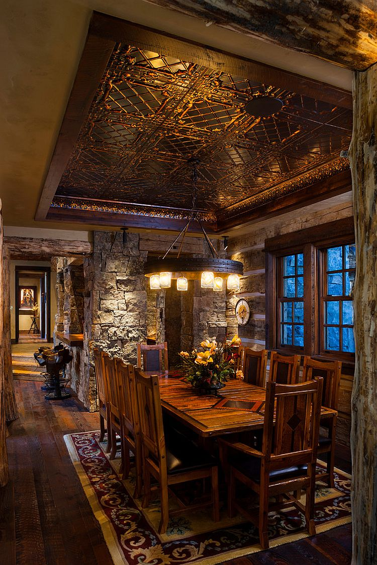 Log-cabin-dining-room-crafted-from-stone-and-reused-materials