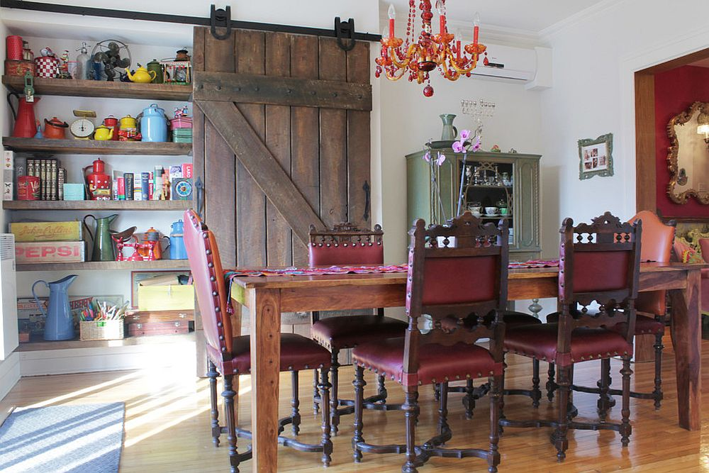Reclaimed-barn-door-in-the-dining-room-hides-a-large-shelf